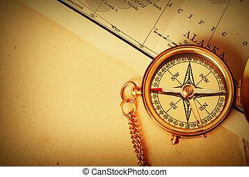 Antique brass compass over old map - Antique brass compass...