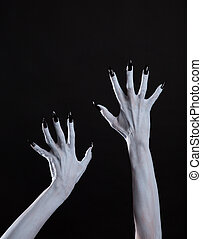 White ghost or witch hands with sharp black nails, body art