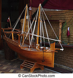 Model dhow and Qatari flag - A large model of a dhow with...