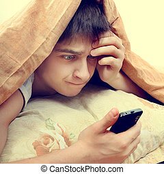 Stressed Teenager with Cellphone