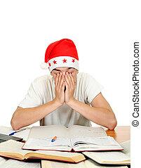 Sad Teenager in Santa Hat - Sad Student in Santa's Hat on...