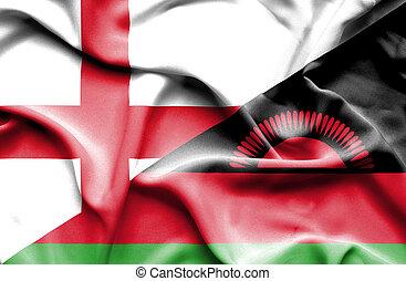 Waving flag of Malawi and England