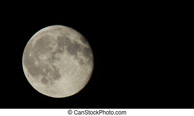 Full moon moving in the night sky - Full Moon in a cloudy...