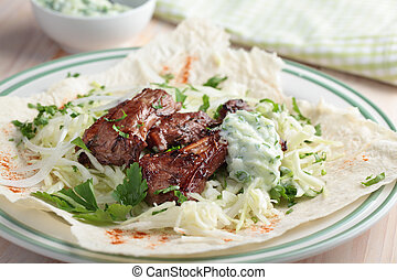 Gyro closeup - Gyro with lamb meat, cabbage, parsley, and...