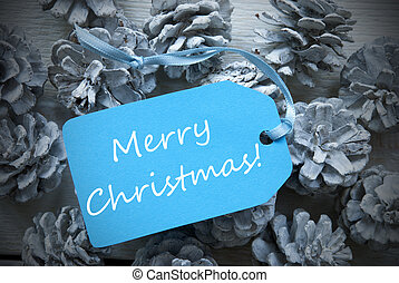 Light Blue Label On Fir Cones With Text Merry Christmas