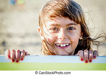 Beautiful eight year old girl smiling on the beach
