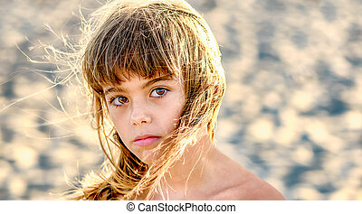 Beautiful eight year old girl  on the beach