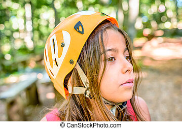 Profile of a beautiful eight year old girl in adventure park