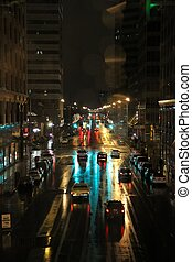 Night Scene of Wet City Streets - View of ciy street at...