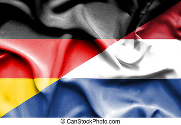 Waving flag of Netherlands and Germany