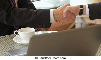 Close up shaking hands in a restaurant