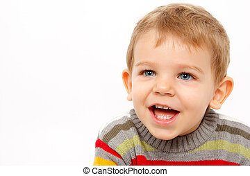 Happy boy in winter clothes laughing