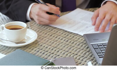 Signing a contract during a coffee break - Close up signing...