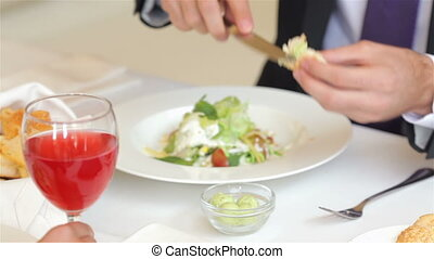 Butters a during a business lunch - Close-up image butters a...