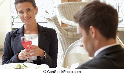 Woman hold a glass of juice - Smiling business woman during...