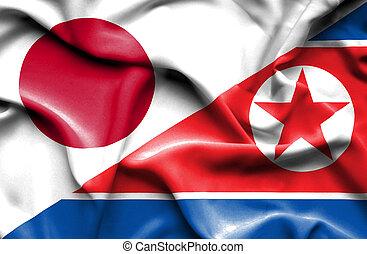 Waving flag of North Korea and Japan - Waving flag of North...