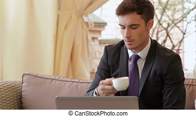 Businessman using a smartphone - Young businessman using a...