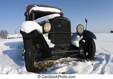 Car wreck in the snow in the countryside
