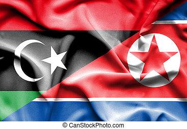 Waving flag of North Korea and Libya