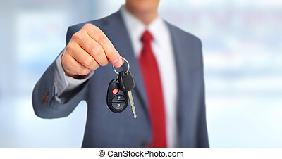Car keys. - Hand with a new Car keys over garage background.