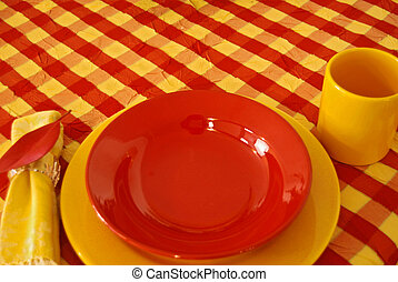 Check It Out - Bright bold dinnerware on checkered...