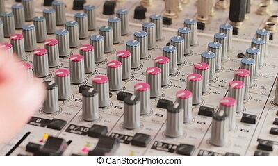 Working with Sound mixing console. - Sound engineer working...
