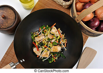 grilled chicken with stir fry in a wok