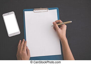notebook, and blank white mobile phone. mock up - A portrait...