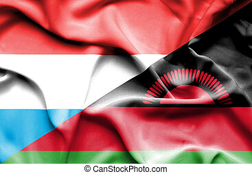 Waving flag of Malawi and Luxembourg