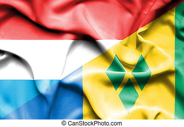 Waving flag of Saint Vincent and Grenadines and Luxembourg