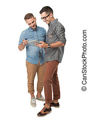 Two young man looking at a tablet pc, isolated