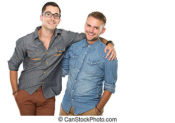 Two young man standing next to each other, smiling