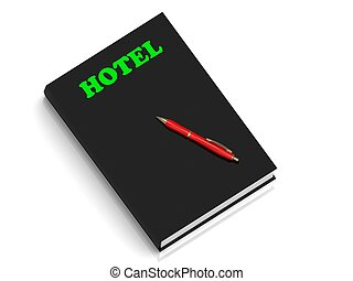 HOTEL- inscription of green letters on black book on white...