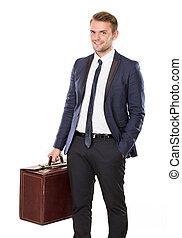 business trip - portrait of Businessman holding a suitcase...