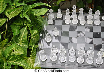 Classic Chess Board - A glass chess board with glass chess...