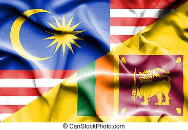 Waving flag of Sri Lanka and Malaysia