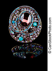 jewellery brooch isolated on black background. multicolored