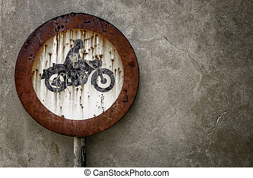 Road sign ban for motorcycles, rusted from the elements.