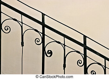 Old iron banister - Closeup of vintage wrought-iron banister...