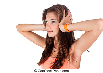 Hear no evil. Young pretty woman covering her ears