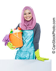 young woman wearing hijab holding a bucket full of cleaning...