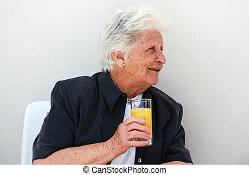 smart old lady with orange juice