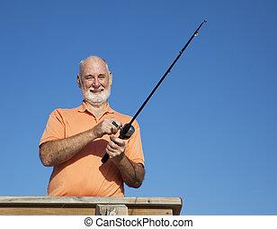 Portrait of Senior Fisherman - Senior man enjoys fishing off...