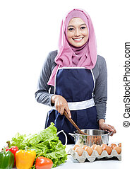 young smiling housewife preparing making soup for dinner -...