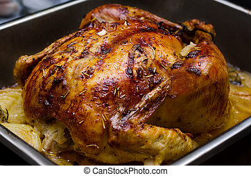 Whole roasted chicken with onion and garlic