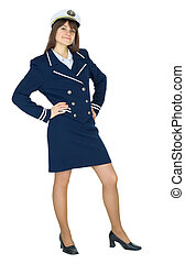 Young beautiful woman in a uniform of the sea captain standing on a white background