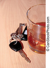 drinking on the job - whiskey glass and keys on office desk...
