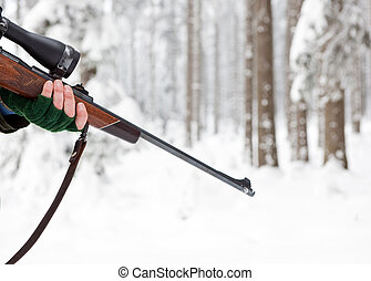 Rifle - Hand of a Hunter, holding a rifle in a winter forest