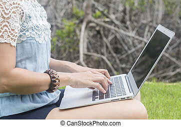 young women using laptop computer at home.