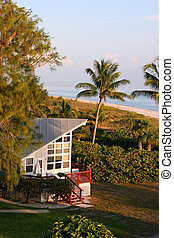 oceanfront beach home at sunset Sanibel Florida